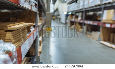 Large Warehouse Logistic And Distribution Center. Interior Of Warehouse With Rows Of Shelves With Bi