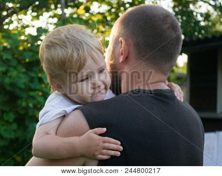 The Father Comforts The Little Son. Dad Hugs And Comforts The Baby. When A Child Is Afraid Of A Stro