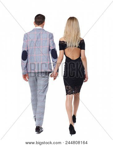 Back view of two business people.  Rear view people collection. backside view of person. Isolated over white background. Young business couple in suits goes holding hands