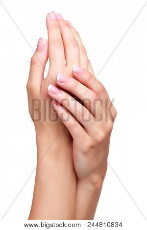 Beautiful female hands against white background, isolated