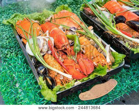 Shellfish plate of crustacean seafood with fresh lobster as an ocean gourmet dinner