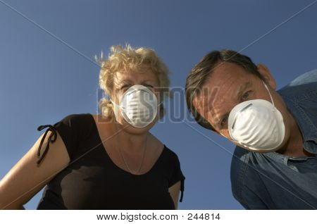 Man And Woman In Masks