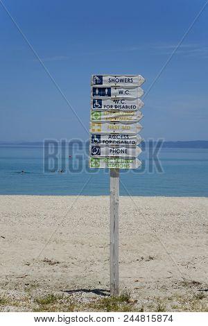 signpost on summer beach