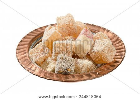 Traditional Turkish delight in copper plate isolated on white background.