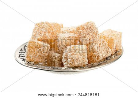 Traditional Turkish delight in vintage plate isolated on white background.