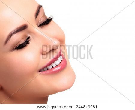 Smiling youg woman's face. Isolated on white background