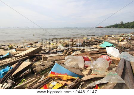 SANDAKAN, MALAYSIA - CIRCA JUNE 2018: Plastic pollution environmental problem. Plastic garbage dumped in sea washes up onto beach. Environmental problem.