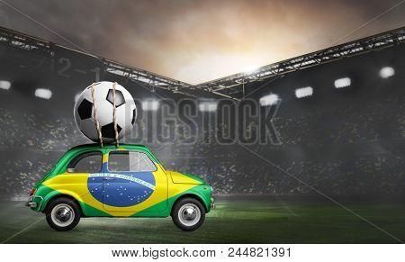 Brazil flag on car delivering soccer or football ball at stadium
