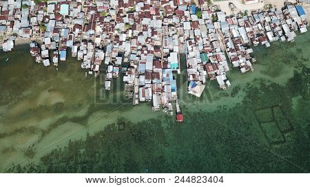 Poor slum in Asia. Villages like this are at risk from climate change and rising sea levels