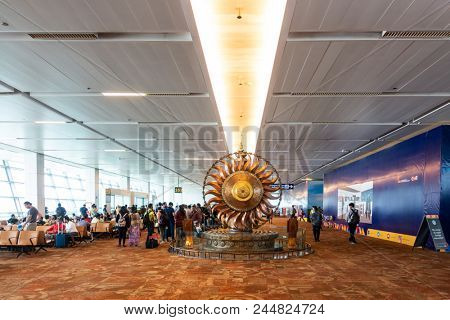 NEW DELHI, INDIA - CIRCA APRIL 2017: Back of the Surya bronze statue at Indira Gandhi International Airport, Terminal 3. Surya is the solar deity in Hinduism.