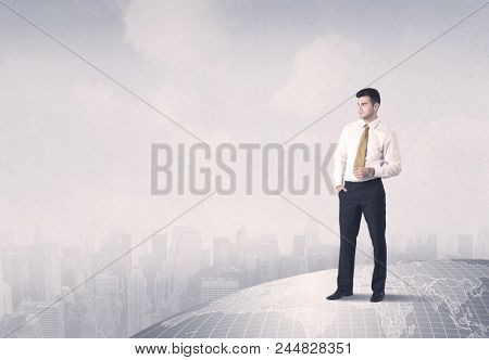 A happy, well dressed construction manager drawing with a pen and planning while standing on top of the earth concept.