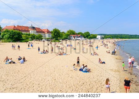 SOPOT - MAY 26: Tourists enjoy the sunny weather and relaxing on the Baltic sea beach on 26 May 2018 in Sopot, Poland.
