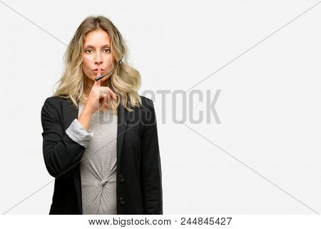 Young woman operator from call center with index finger on lips, ask to be quiet. Silence and secret concept
