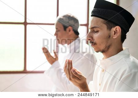 Muslim men making Dua to Allah