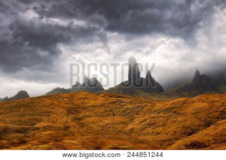The Old Man of Storr emerges from the clouds. Autumn in Trotternish, on the Isle of Skye, Scottish Highlands, Scotland.