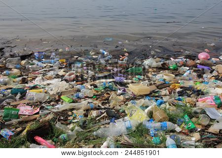 SANDAKAN, MALAYSIA - 12 JUNE 2018: Plastic pollution environmental problem. Plastic bottles, bags and other rubbish pollute the ocean and beach