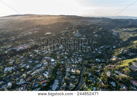 Aerial view of Holmby Hills and Benedict Canyon neighborhood in Beverly Hills and Los Angeles, California.