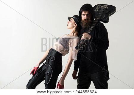 Cool Rock And Roll Couple On White Background. Rock Couple Of Sexy Girl And Bearded Man With Guitar.