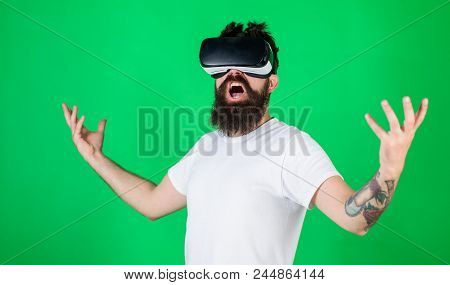 Man With Beard In Vr Glasses, Green Background. Power Concept. Hipster On Shouting Face Raising Hand
