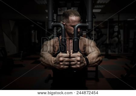 Muscular Tough Man In Gym In Pecs Fly Machine, Shallow Depth Of Field