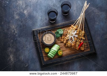 Chicken Satay Or Sate Ayam - Malaysian Famous Food. Is A Dish Of Seasoned, Skewered And Grilled Meat