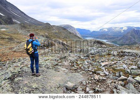 Norway Female Tourist Takes A Photo - Besseggen Trail Hike In Jotunheimen National Park.
