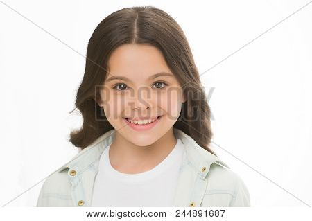 Child Charming Smile Isolated White Background Close Up. Charming Cutie. Kid Girl Long Curly Hair Po