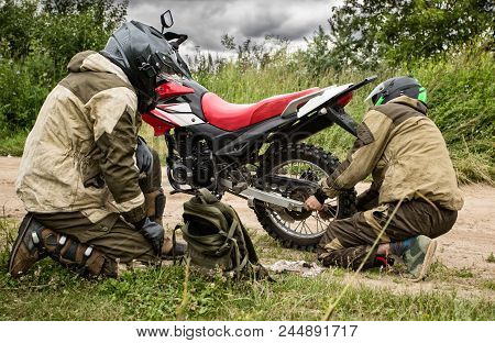 Two Mens Wearing Motorcycle Helmet And Safety Uniform Sitting On Dirt Bike Outdoors, Beautiful Sceni