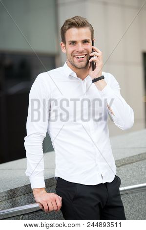 Always Available. Man Well Groomed White Shirt Speak Phone Urban Background. Businessman Serious Hap