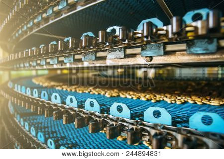 Close Up Of Conveyor Line At Confectionary Factory, Food Industry. Cookie And Pastry Production.