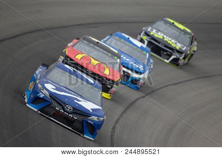 June 10, 2018 - Brooklyn, Michigan, USA: Martin Truex, Jr (78) races off turn one during the FireKeepers Casino 400 during a weather delay at Michigan International Speedway in Brooklyn, Michigan.