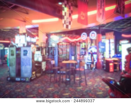Vintage Blurred Arcade Game Room At Entertainment Complex