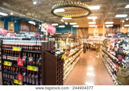 Blurred Wine Shelves Customer Shopping  At Supermarket In Usa