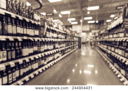 Vintage Blurred Wine Shelves And Price Tags At Supermarket In Usa