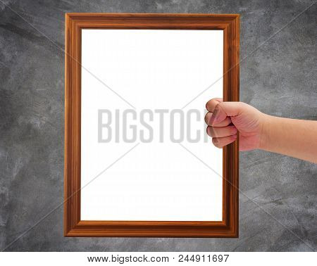 Communication And Announcement Concept, Hand Holding Wooden Frame On Concrete Background