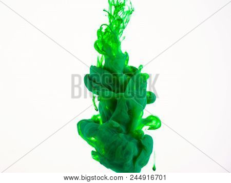 Close Up View On Green Acrylic Paint Dropped Into Liquid. Colourful Droplet Of Green Ink Movement, A