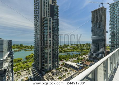 Residential Buildings In Downtown Toronto On The Lake Shore Of Ontario. View From The Balconie