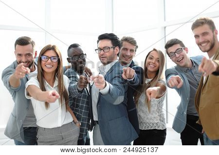 group of successful young men pointing at you