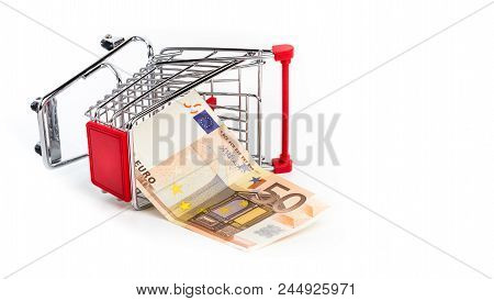 Shopping Cart With 50 Euro Bill Inside. Shopping Cart Is Upturned, Concept Symbol Of Bankruptcy, Cri