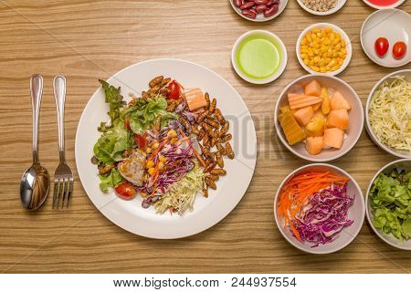 Vegetable Salad In The White Plate -  Vegetable Salad With Worm Insects On The White Plate. Healthy