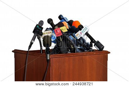 Microphones On Lectern During Press Interviews On White Background