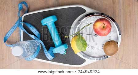 Flat Lay Scale Weighs Person With Water Bottle Fruit Dumbbells And A Meter Symbol Of Good Hygiene Of