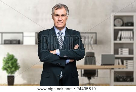 Senior manager in his office