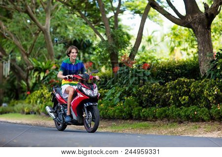 Teenager Riding Scooter. Teenage Boy Fun On Motorbike Ride On His Way To School. Student On Motorcyc