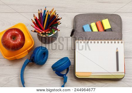 School Supplies. Headphones, Yellow Sandwich Box, Apple, Metal Stand For Pencils With Color Pencils,