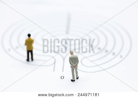 Miniature People : Businessmen In The Maze. Image Use For To Solve Problems, Finding Solution And Th