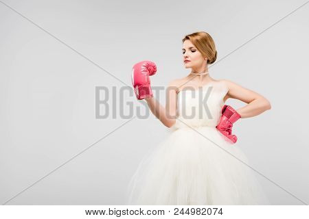 Strong Bride Posing In Wedding Dress And Boxing Gloves, Isolated On Grey, Feminism Concept