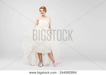 Bride In White Wedding Dress And Pink Sneakers, Isolated On Grey, Feminism Concept