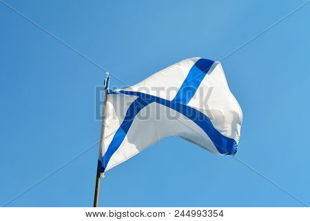Naval flag of the Russian Navy St. Andrew on a blue sky background. Russian navy day concept. poster