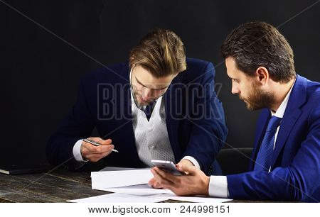 Business Partners With Smartphone, Documents And Contract. Client Signs Loan Agreement. Busy Men In